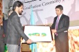 General Manager Shah Pour presents a gift on behalf of NAEC to Mr. Raheel Formoli