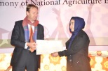 Ambassador of Netherlands Mr Henk Jan Bakker gives certificate to the top student